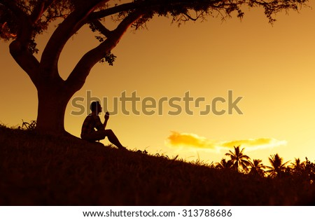 Young male with hands folded together in a beautiful setting. (prayer and desperation concept) - stock photo