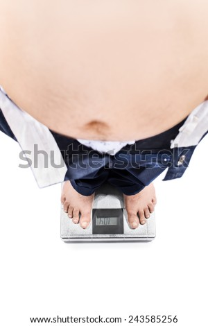Young male with weight problems standing on a scale isolated on white background - stock photo