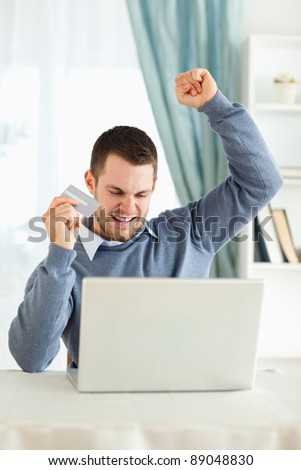 Young male won an online auction - stock photo