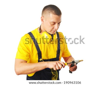 young male worker with instruments isolated on white background