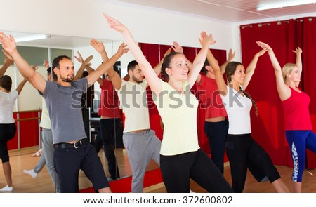Young males and females smiling and dancing contemp dance in studio - stock photo