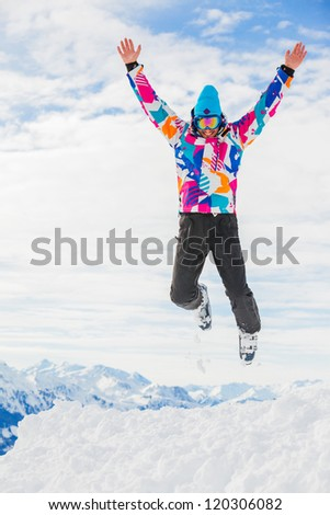 Young man a ski outfit jumping in snow at winter outdoor in the Zillertal Arena, Austria