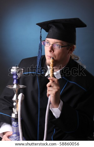 young man after his graduation with hookah - stock photo