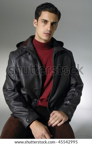 young man against shot in studio - stock photo