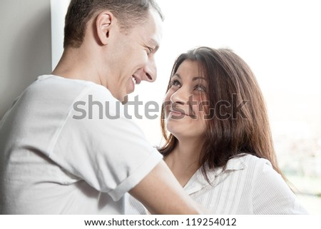 young man and girl look at each other and laugh - stock photo