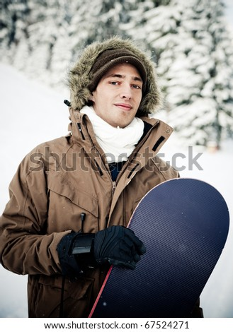 Young Man and his Snowboard - stock photo