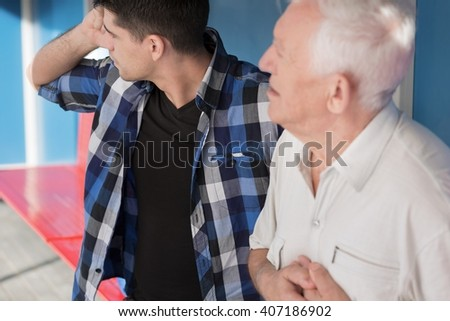 Young man and senior man with chest pain - stock photo