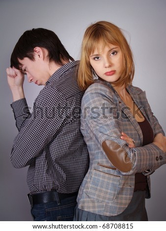Young man and the woman quarrel. Conflict