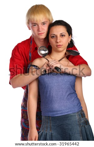 Young man and woman embraces with utensil. Isolated.