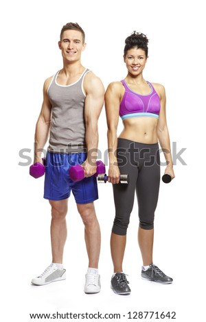 Young man and woman exercising in sports outfits on white background smiling - stock photo