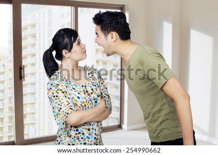 Young man and woman fighting in a home - stock photo
