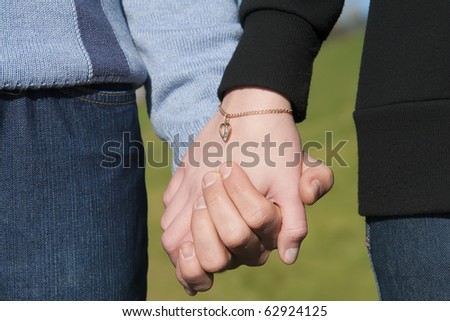 Young man and woman holding hand in hand - stock photo