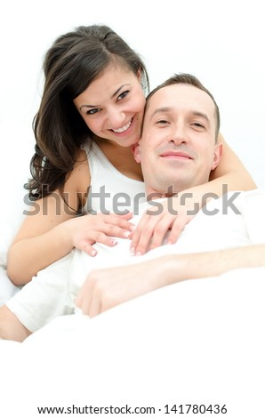 Young man and woman in bed - stock photo