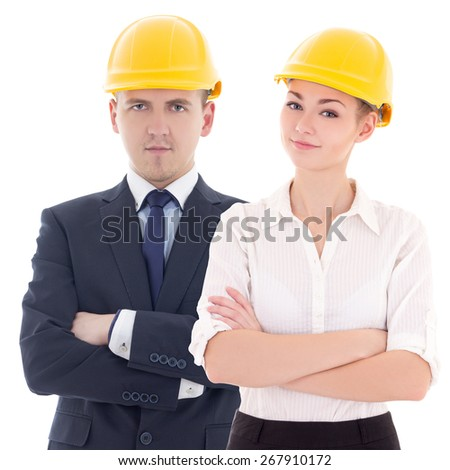 young man and woman in builder 's helmets isolated on white background - stock photo