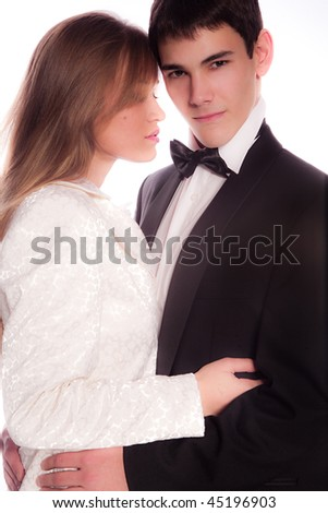 young man and woman in nice clothes on the white background - stock photo