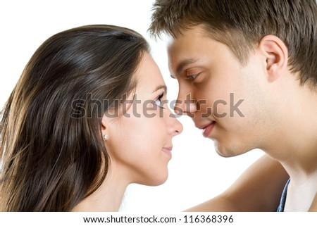 Young man and woman looking for tenderness and closeness - stock photo