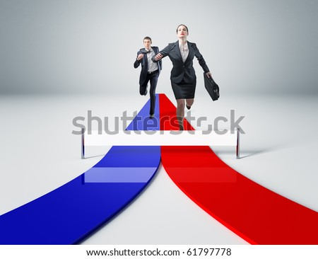 young man and woman running for success - stock photo