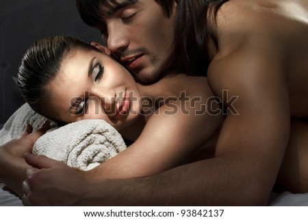 Young man and woman sleeping in white bed - stock photo