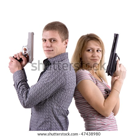 young man and woman standing back to back with the pistols in their hands - stock photo