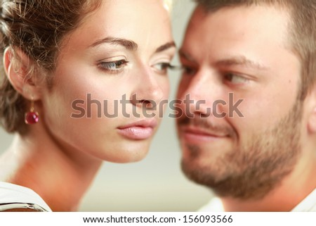 Young man and woman together over white background - stock photo
