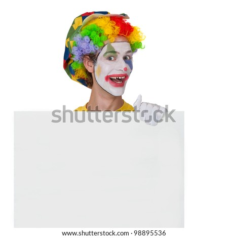 Young man as clown holding a white board - stock photo