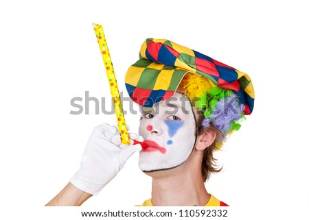 Young man as clown with whistle - isolated - stock photo