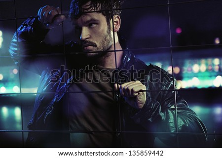 Young man at night - stock photo
