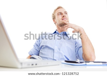 young man at office, sitting leaning back daydreaming