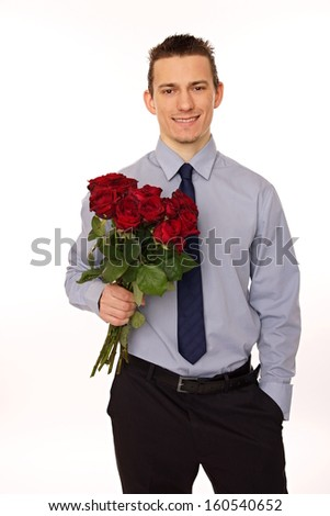Young man at shirt and tie hold bouquet red roses