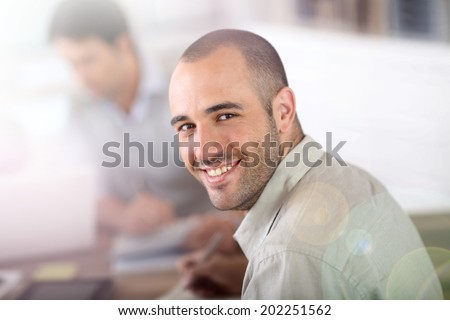 Young man attending business school project - stock photo