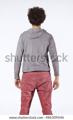 Young man back portrait in grey blouse.