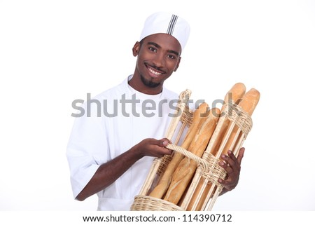 Young man baker smiling - stock photo