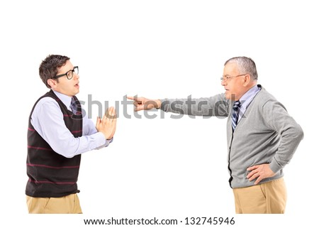 Young man begging and angry mature man gesturing with finger isolated on white background - stock photo