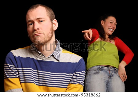 young man being laughed about by mean girlfriend - stock photo