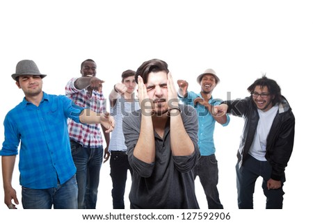 Young Man Blamed By His Friends On White Background