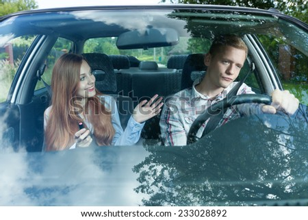 Young man bored with his female passenger - stock photo