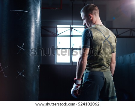 Young man boxing workout in an old gym.