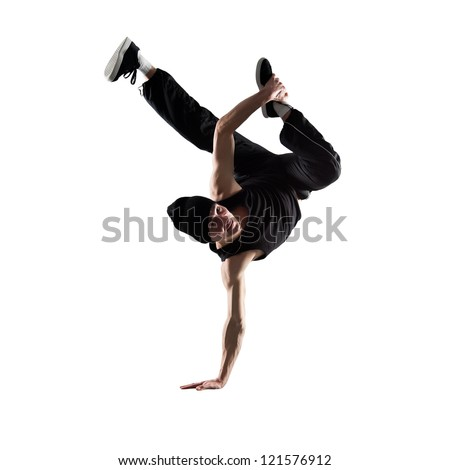 Young man breakdancing in the room - stock photo