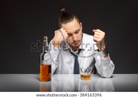 Young man businessman trying to free from addiction to alcohol. Addicted to alcohol, alcoholism concept, social problem