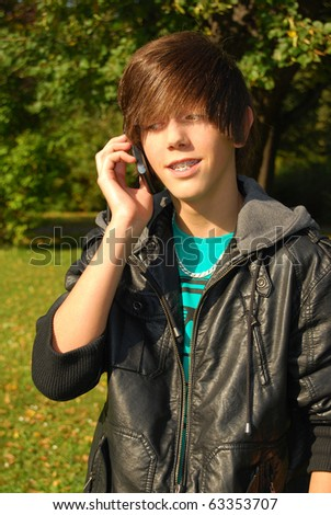 Young man calling by phone in the park