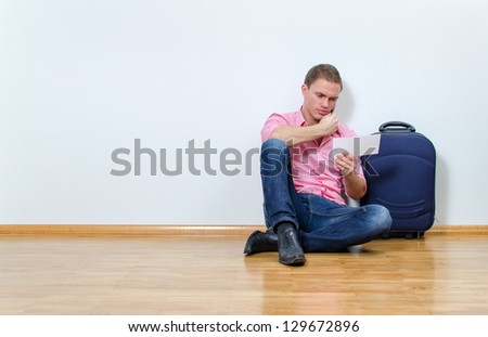 Young man calling helpdesk to get information about his flight - stock photo