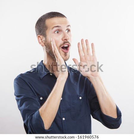 young man calling, screaming good news - stock photo