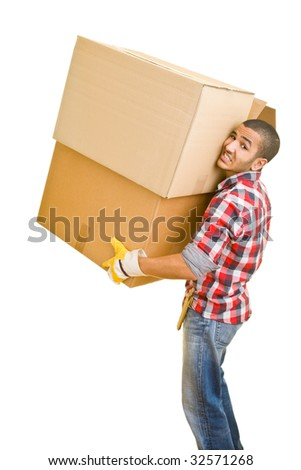 Young man carrying huge boxes - stock photo