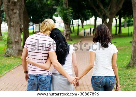 young man cheating on his girlfriend with her best friend - stock photo