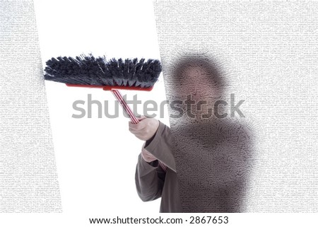 Young man cleaning windows with a broom - stock photo