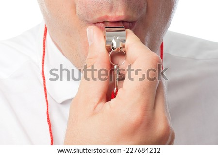 Young man close up over white background. Using a whistle - stock photo