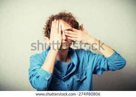young man closed eyes his hand