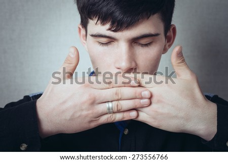 young man closes her mouth - stock photo