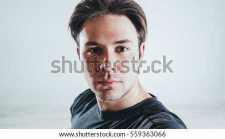 Young man closeup portrait on gray background
