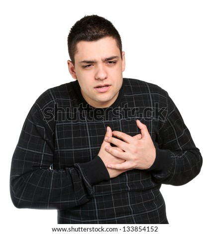 Young man clutching his chest in pain.